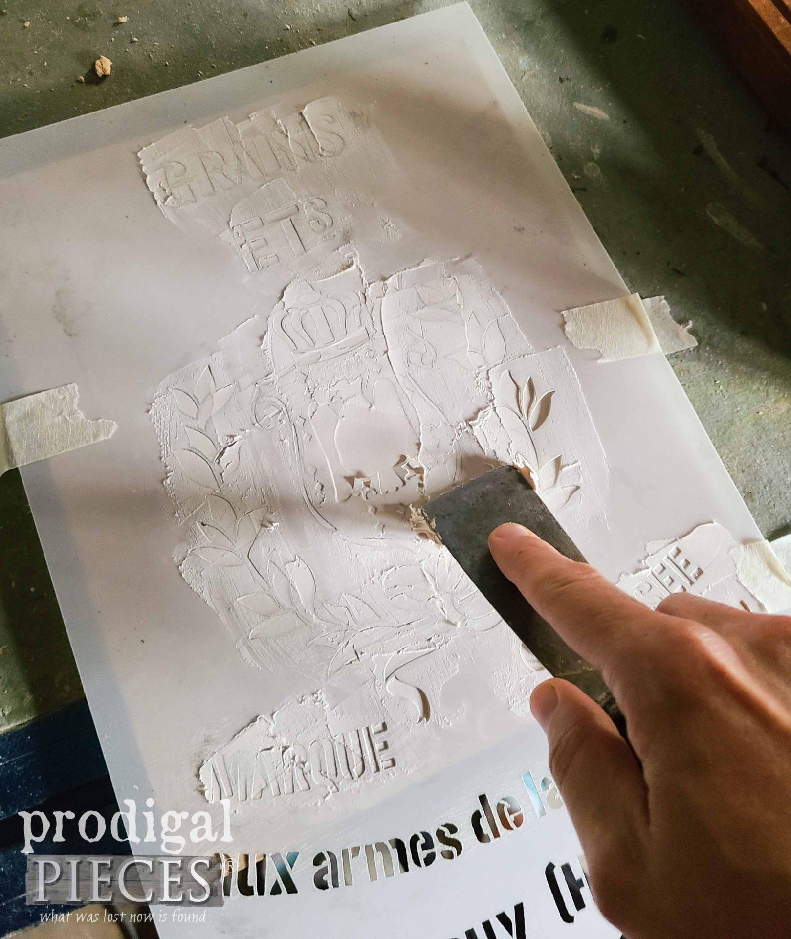 Applying Spackling to Stencil for Upcycled Frame Makeover | prodigalpieces.com