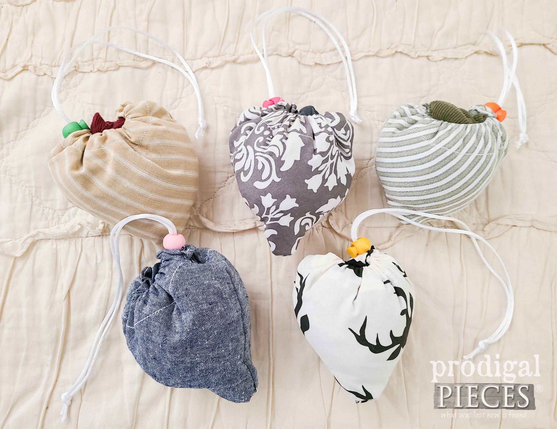 Folded Set of DIY Reusable Compact Folding Bags by Larissa of Prodigal Pieces   prodigalpieces.com #prodigalpieces #upcycle #diy #refashion #sewing #shopping