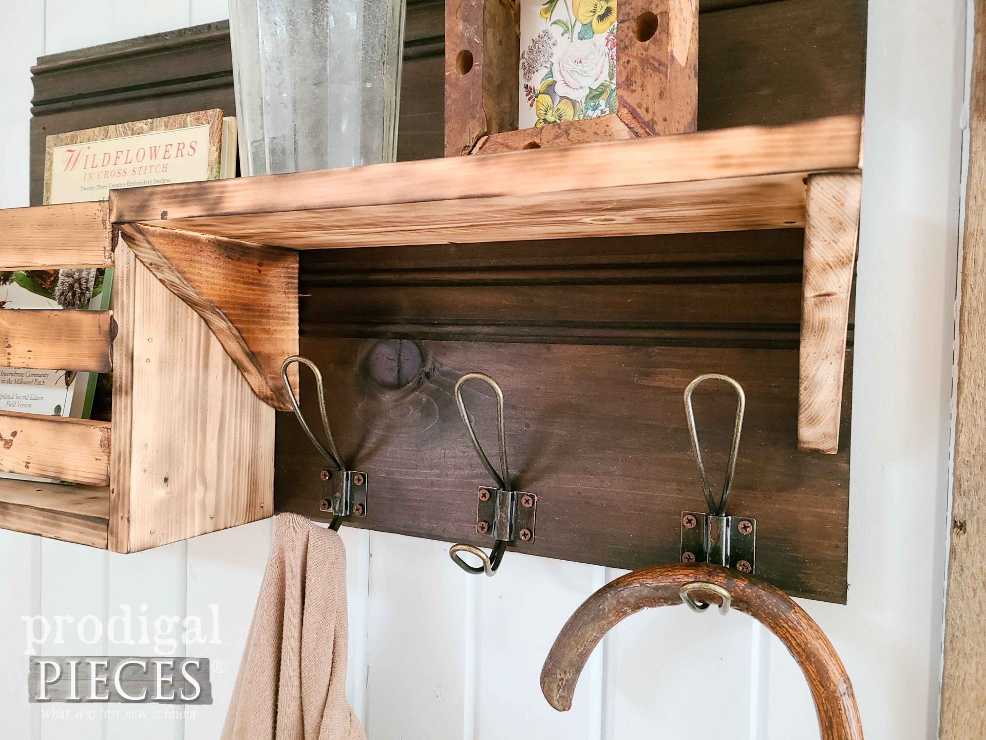Wire Coat Hooks on DIY Scorched Wood Shelf Tutorial by Larissa of Prodigal Pieces | prodigalpieces.com #prodigalpieces #rustic #farmhouse #storage