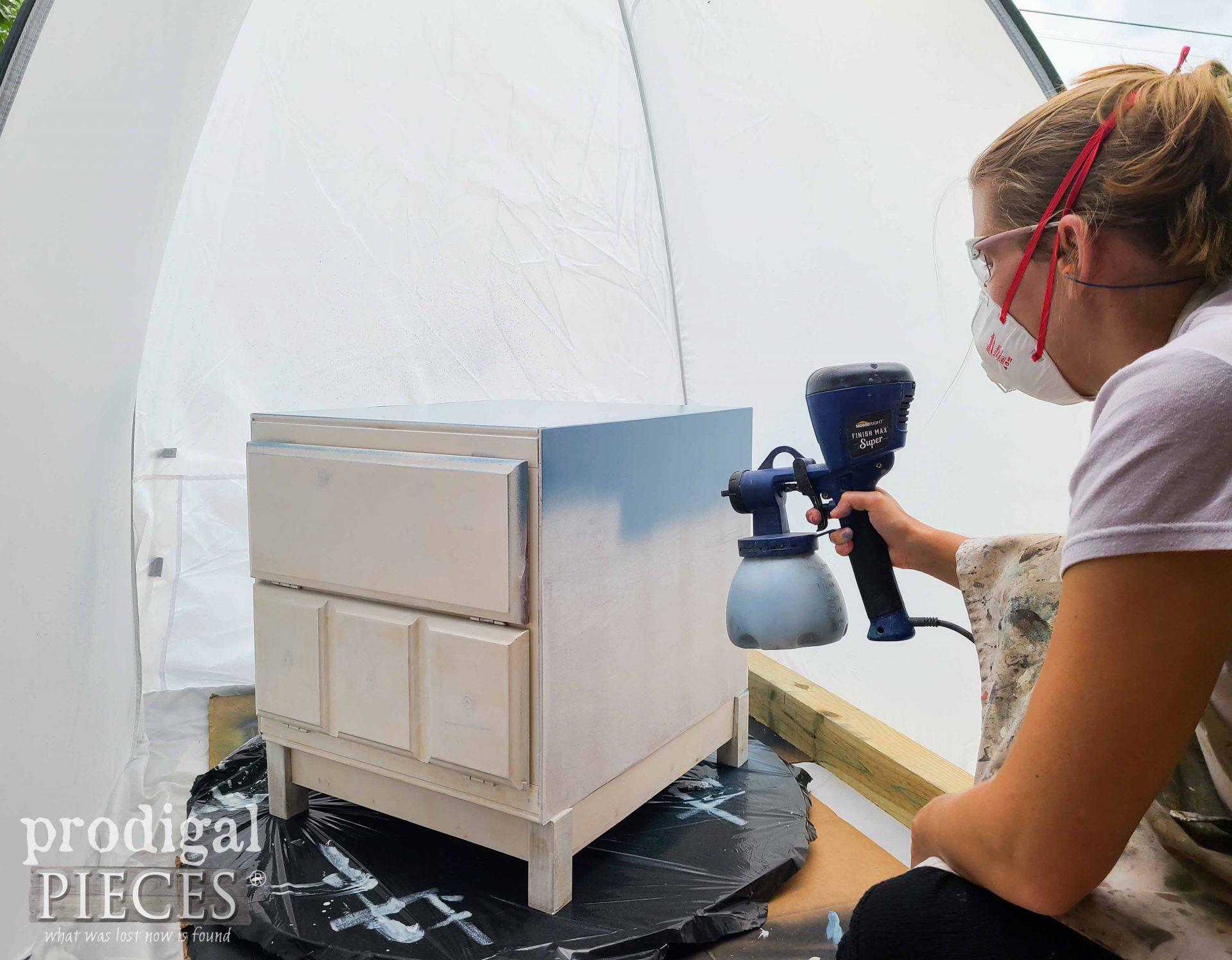 Larissa Spray Painting Rebuilt Vintage Cabinet Side Table   prodigalpieces.com