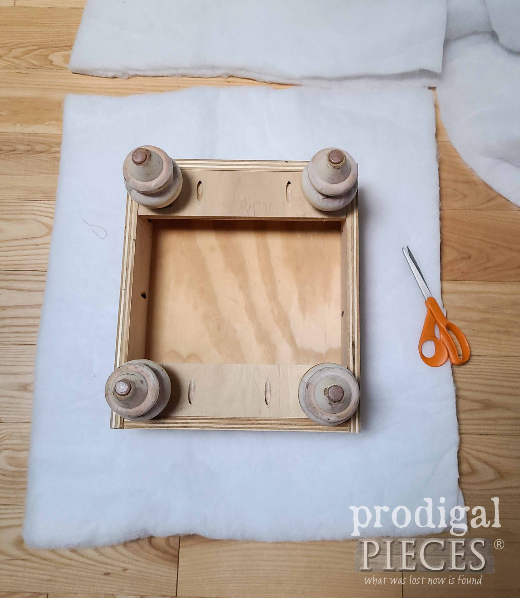 Cutting Batting for Upholstyer on Upcycled Ottoman | prodigalpieces.com