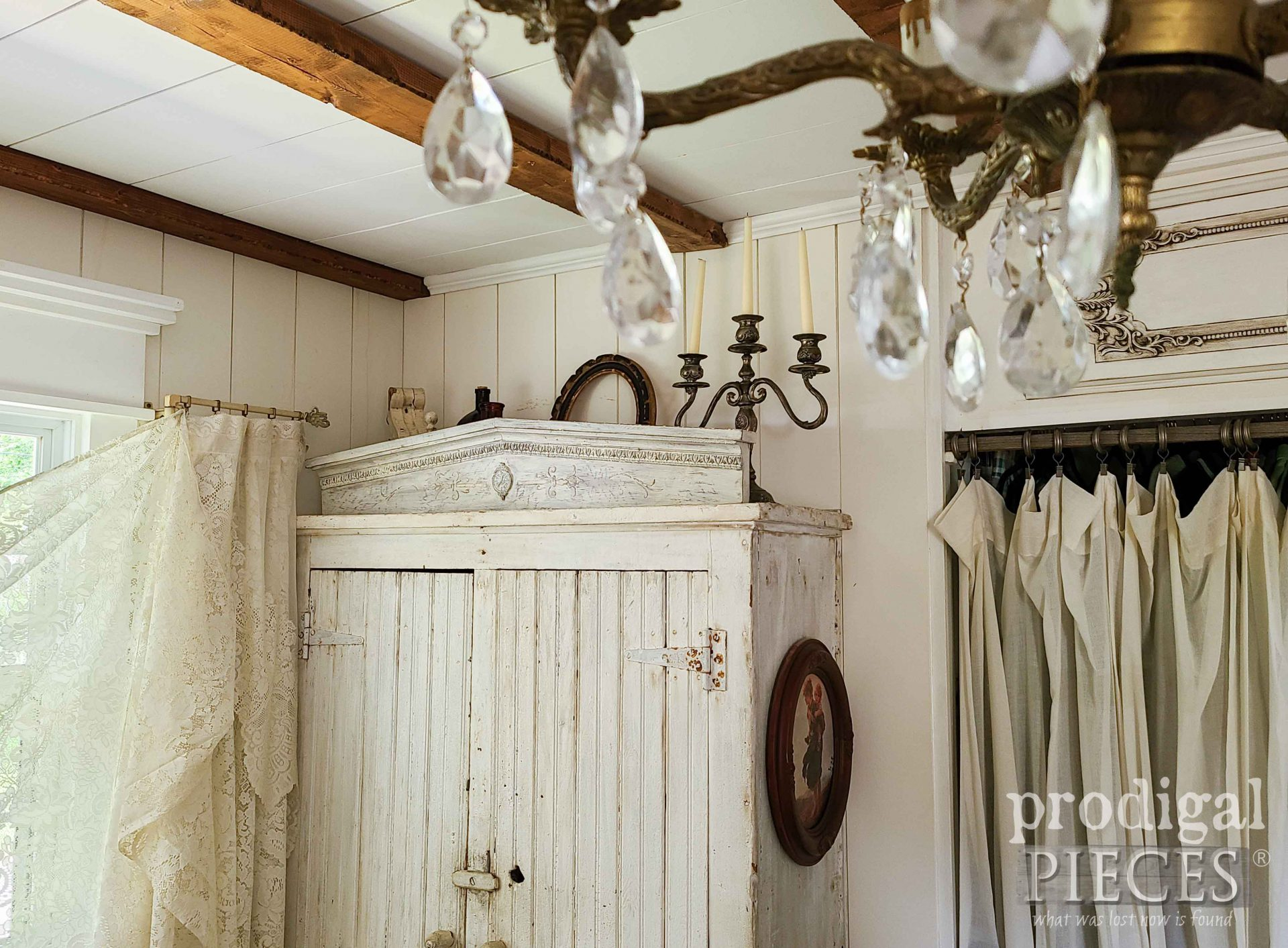 Crystal Chandelier in Farmhouse Bedroom with Pediment | prodigalpieces.com #prodigalpieces #farmhouse #bedroom