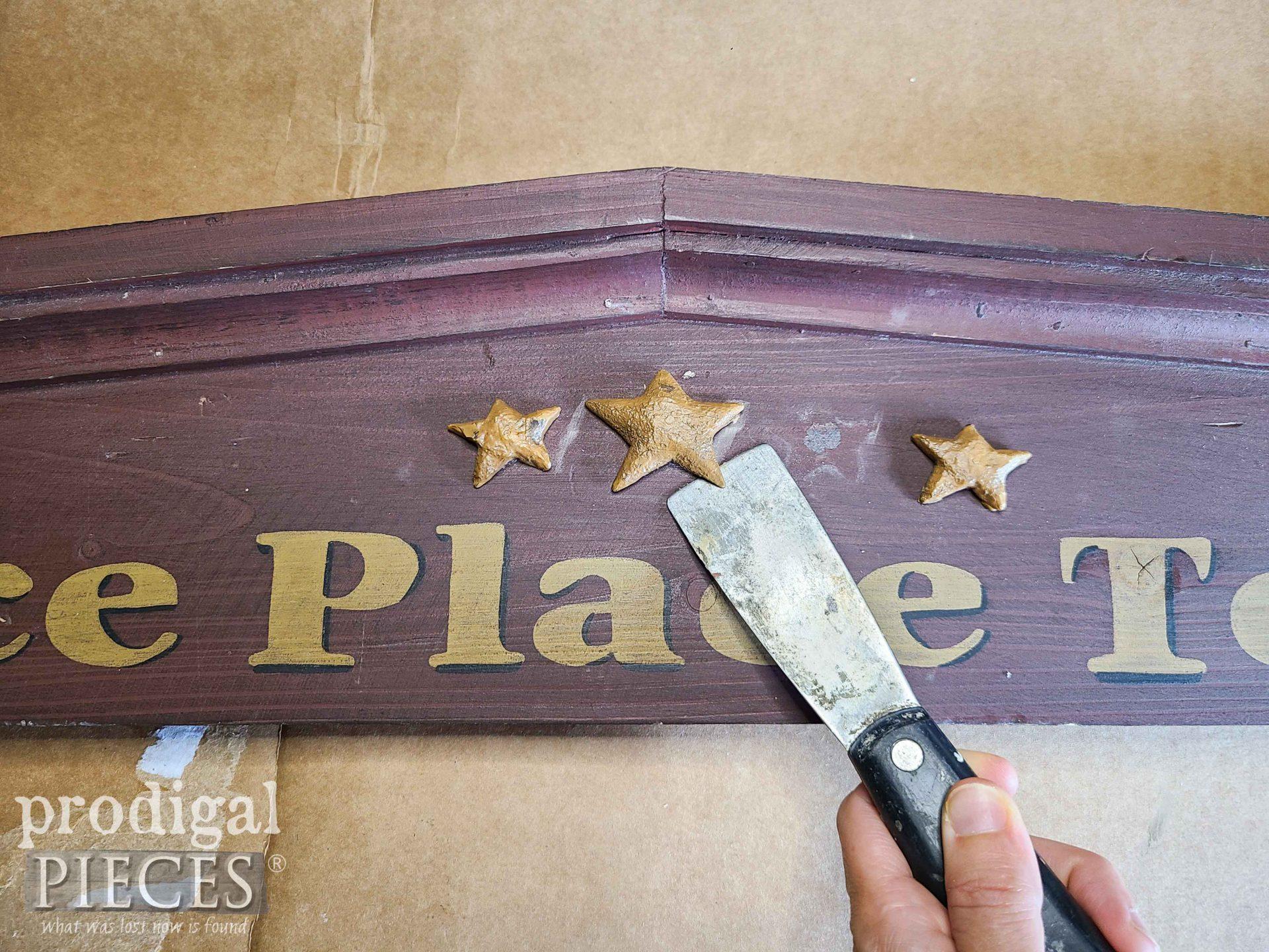 Removing Stars from Farmhouse Pediment | prodigalpieces.com