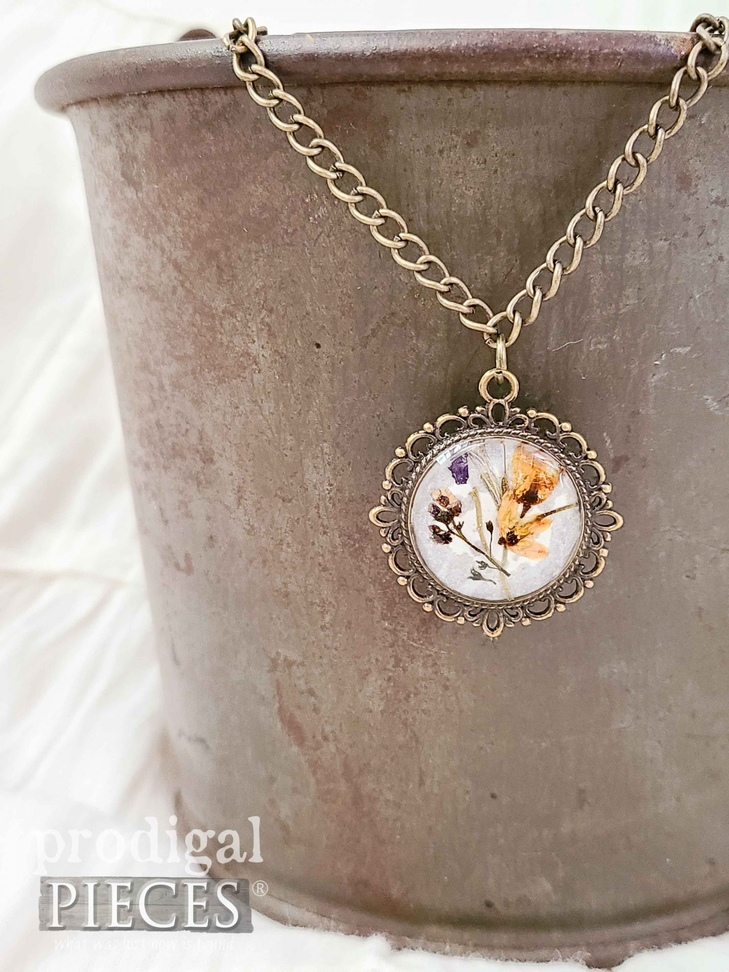 Dried Botanical Necklace Made with Resin by Larissa of Prodigal Pieces   prodigalpieces.com #prodigalpieces #necklace #jewelry #diy #crafts